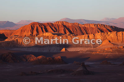 View across the Amphitheatre of the Valley of the Moon from Duna Mayor as the sun is setting, Atacama