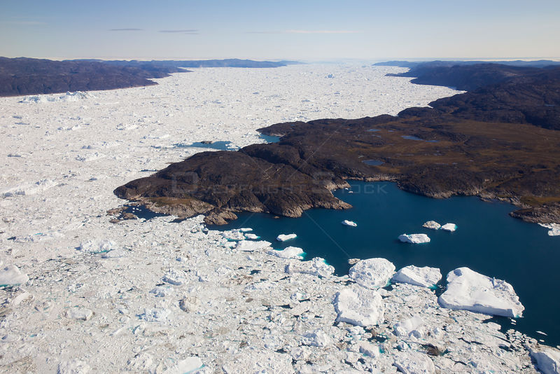 Aerial view of the Ilulissat Icefjord, with the Sermeq Kujalleq Glacier or Jakobshavn Isbrae entering the sea, near  Ilulissat Icefjord UNESCO World Heritage Site, Greenland.
