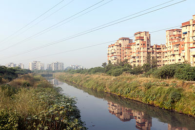 India - New Delhi - The Najafgarh drain - polluted with effluent and industrial chemicals passes through new housing complexes at Dwarka