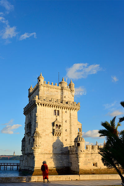 Torre de Belém (Belem Tower), a UNESCO World Heritage Site built in the 16th century in Portuguese Manueline Style at twilight. It was designed by the architect Francisco de Arruda. The River Tagus Estuary in the background. Lisbon, Portugal (MR)