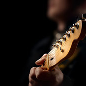Guitarist playing close-up