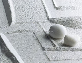 Background of White Sand and two stones.
