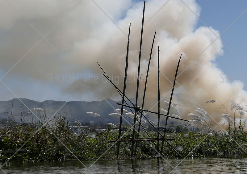 Smoke at reed fields,Inlelake,Myanmar,Burma