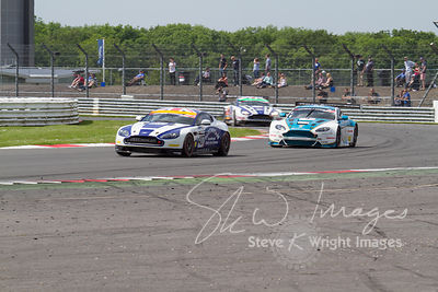 Aston Martins racing for position, at the Silverstone 500 - in the third round of the British GT Championship 2014 - 1st June 2014