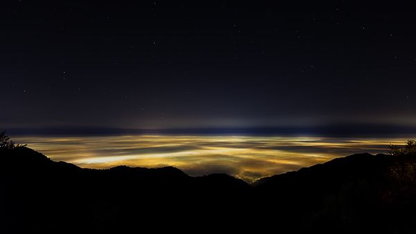 Bird's Eye: Wide Shot Of Mist & Stratus Clouds Covering A Lit Up Los Angeles Basin