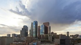 Wide Shot: Fiery Sunset, Reflecting Cloud Decks, & Electrifying L.A. Skyline