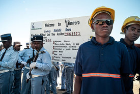 MADAGASCAR, TSIMIRORO - Gendarmes and Madagascar Oil's employees wait for the President of Madagascar Hery Rajaonarimampianina during the ceremony of the first test sales of Tsimiroro's crude oil on June 18, 2014. Tsimiroro is a large deposit of heavy oil exploited by Madagascar Oil company, western of Madagascar. PHOTO : RIJASOLO / AFP PHOTO