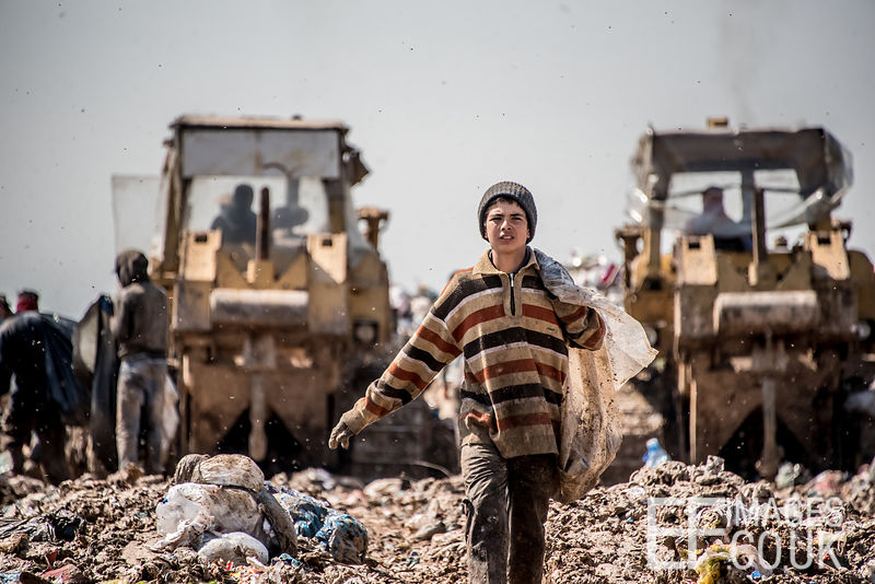 A young boy working at Kani Qirzhala landfill site near Erbil