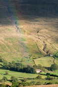 Rainbow over moorland after an autumn rain shower UK.