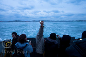 Tourist taking self-portraits from the ferry, in their way to Toronto Island