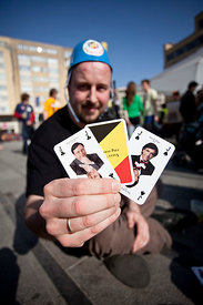 "29 Mar 2011 - Brussels (Belgium) - A young man shows a game of cards made with Belgian politicians, during a demonstration for Belgian unity. The Belgian association ""Pas en notre nom"" (""not in our name"") demonstrates for the unity of Belgium. Today Belgium has become the world's country which has been the longest without a government. © Bernal Revert/ BELGA"