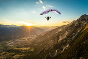 High up in the air, the Alps, a sunset and a full stall glider with Jean Baptiste Chandelier