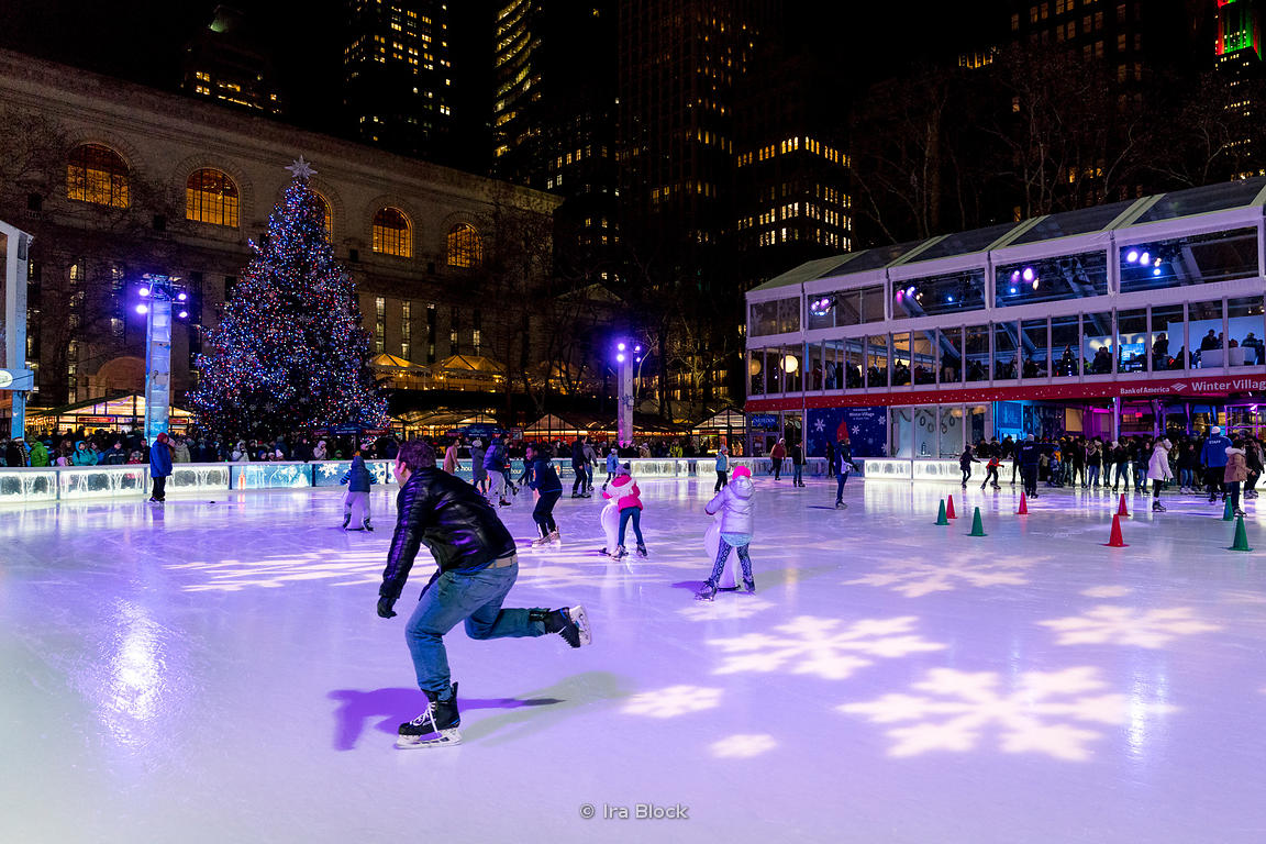 People ice skating on the rink at Bryant Park Winter village in Manhattan, New York City