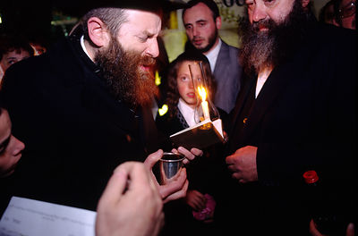 A Rabbi makes a blessing at an Orthadox Jewish wedding in Jerusalem, Israel