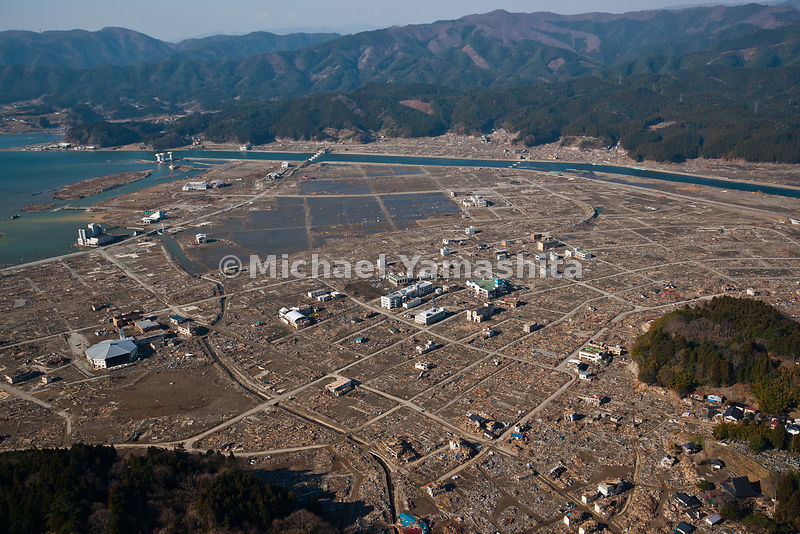 March 11 Great Eastern Japan Earthquake and Tsunami. Measuring 9, biggest ever to hit Japan destroying the NE coast line cities and villages for 200 plus miles. Aerials over Rikuzentakata also shot from ground.  Streets were cleared of debris first action to allow for equipment access to destruction to start clearing and moving into piles.