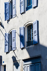 White building with blue shutters, le Puy en Velay