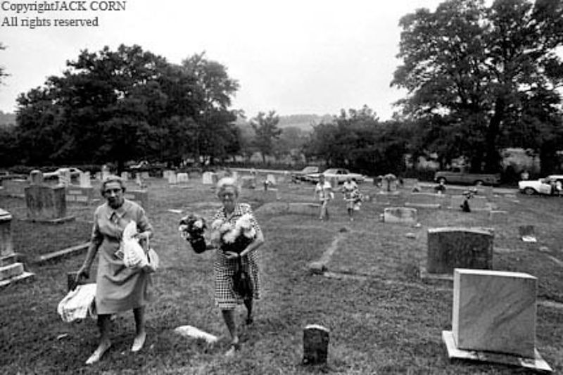 Two  women at grave decoration