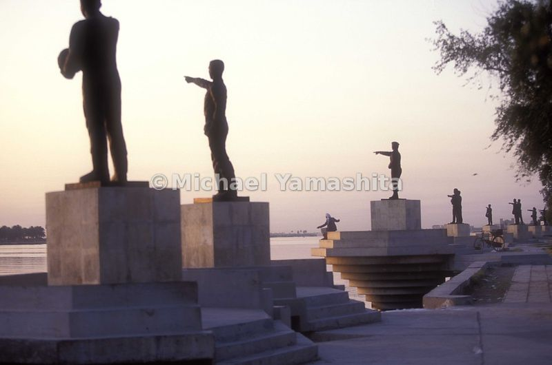Martyrs Statues on the Shtl al Arab River, 61 soldiers pointing to Iran. Built in 1989 after the war, name and date of death of each soldier is inscribed on a plaque to the place they died.