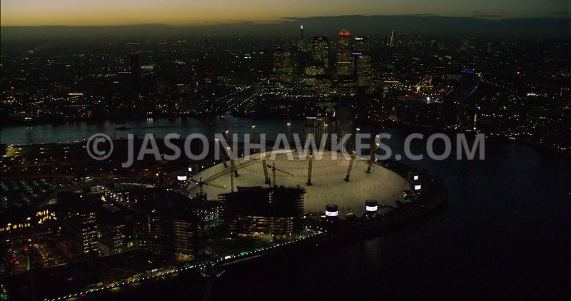 London night aerial footage, O2 Arena with Canary Wharf at night.