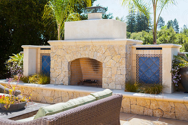 fireclay tile  exterior fireplace with water features