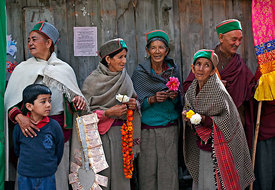 A small gathering of people in a village in Ladakh.