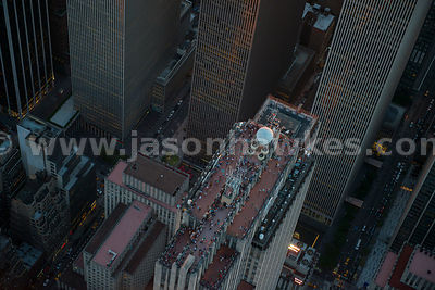 Aerial view of people on top of the GE Building, a skyscraper in Midtown Manhattan that forms the centrepiece of Rockefeller Center