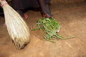 Lady cleaning upoutside her home in rural Kenya.
