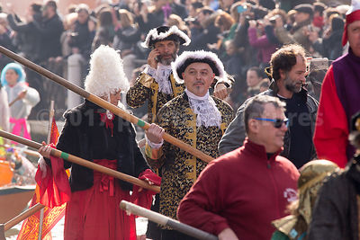 Men in Fur Lined Tricorn Hats in the Venice Carnival Water Parade on the Rio di Cannaregio Canal