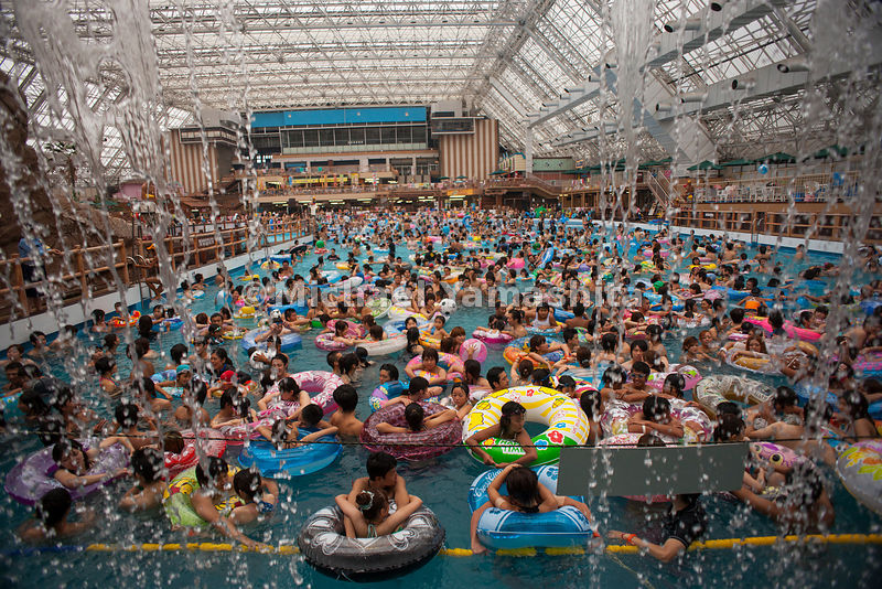 Summerland Wave Pool, Hachioji, Tokyo, Japan.Creates a 1 meter wave for 5 minutes every hour on the hour.  100s of swimmers crowd into the pool in anticipation of waves, then jump out and wait for the next round of waves.