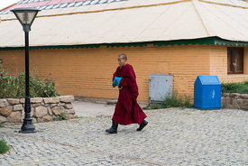 "A young monk at Gandantegchinlen Monastery, Monglia's largest functioning Buddhist monastery in Ulaanbaatar.  The Tibetan name translates to the ""Great Place of Complete Joy""."