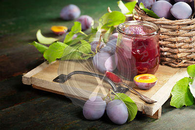 Sweet plums on wooden background. with plum jam.