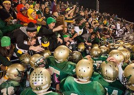 Iowa City West players crowd around the Boot which they bested cross-town rivals Iowa City High to win 44-0 Friday night at Iowa City West, October 5, 2012.(Justin Torner/Freelance)