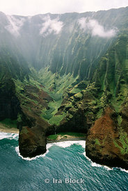 Napali Coast, knife-edged cliffs and overgrown gorges drop to the sea 4,000 feet below. Mist and cloud cover roll in and out of the valley in Kauai, Hawaii