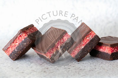 Square pieces of chocolate cherry slice.