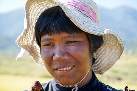 A local woman at rice fields near the Chime Lhakhang Monastery or temple, in Punakha District, Bhutan.