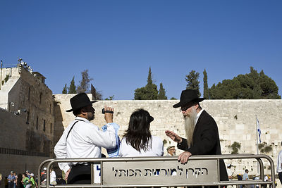 Israel - Jerusalem - A woman talks to two Orthadox Jewish rabbis at the Western ('Wailing') Wall