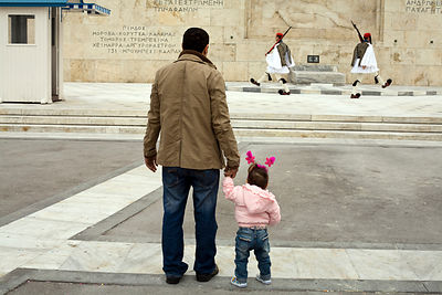 Greece - Athens - A father and his daughter watch two Greek soldiers perform the Changing of the Guard in front of the Tomb of the Unknown Soldier