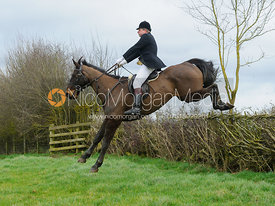 Geoff Bridges jumping a hedge above Klondike