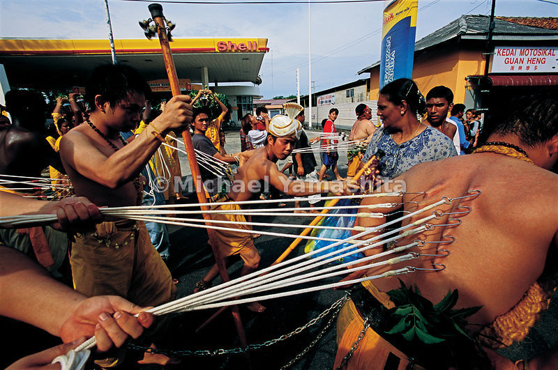 At the peak of the Datak Chachar festival, the procession of penitents, skin punctured with fishhooks, passes through Malacca.