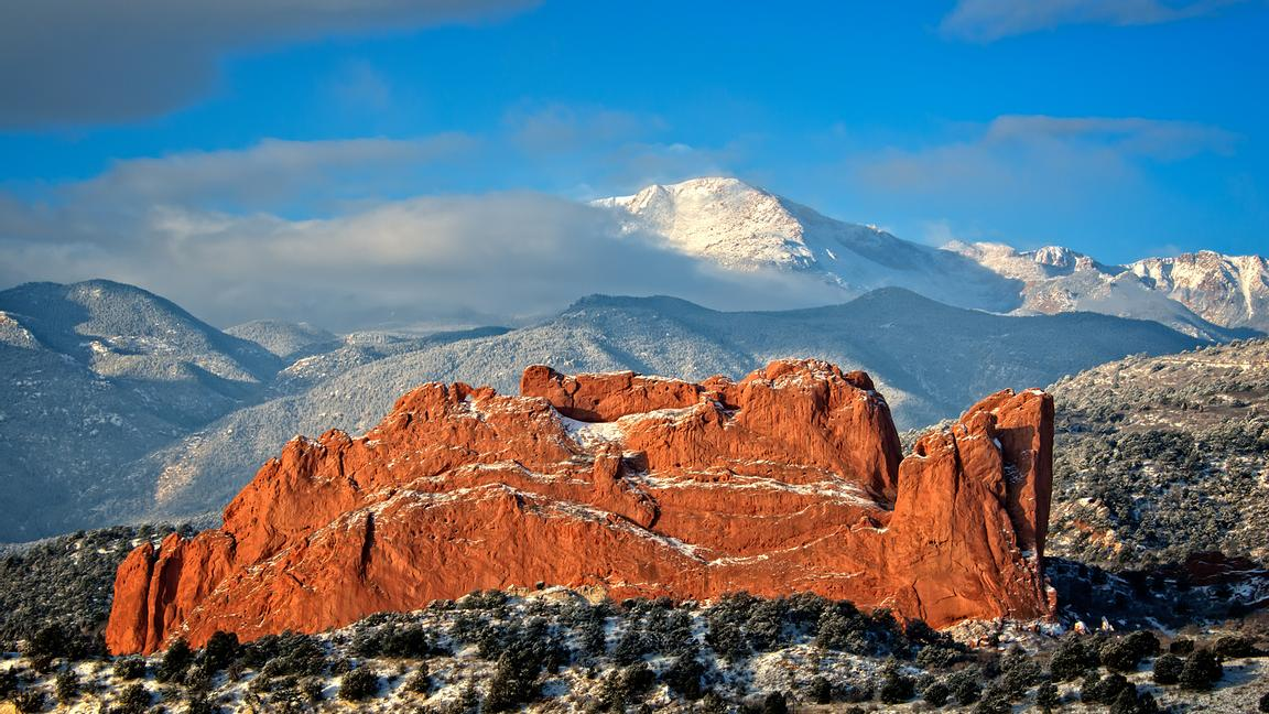 The clouds that shrouded Pikes Peak this morning finally cleared revealing the blustery snow cover slopes and providing the all familiar backdrop for Garden of the Gods.