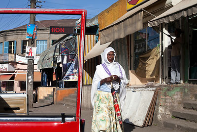 Ethiopia - Addis Ababa - A traditionally dressed woman walking through the Piazza district