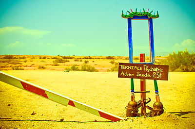 "This sign is part of an art installation in East Jesus, California. ""Wedged between the Chocolate Mountain Gunnery Range and the Salton Sea in southern California's exotic Imperial Valley, East Jesus is an experimental, comprehensive habitat and artwork comprising vernacular architecture, technophilia, common-sense environmentalism, desert survival and sculpture/assemblage using predominantly recycled, re-purposed or discarded materials, sublimating the unwanted and ugly into the purposefully beautiful."" -Charles Russell (Founder)"
