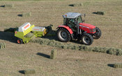 Farmer in Swaledale, North Yorkshire making bales of hay, using a Massey Ferguson 5470 and a Claas baler.