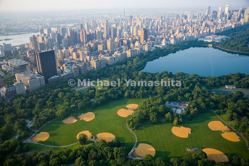 The recently renovated North Meadow, just above the Jaqueline Onassis Reservoir, has had baseball fields since the 1870s.  Central Park.  Manhattan, New York City.