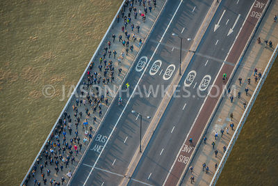 Commuters , people crossing London Bridge. Aerial view