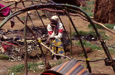 A woman sits in the ruins of her home after an attack by the Interehamwe militia, Gisenyi, Rwanda