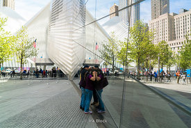 Tourists peek into the glass panes of the 9/11 Memorial Museum near World Trade Center in New York City.