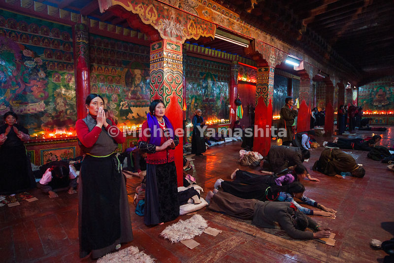 "Locals, who have been invited to Garthar Monastery during a festival, engage in the various stages of the highly ritualized practice of prostration called Chak Tsal, which means ""to sweep clean."""