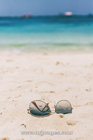 sunglasses on beach for summer holiday