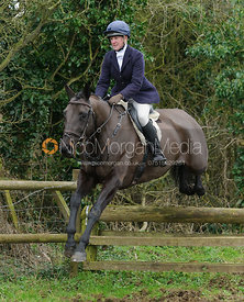 Nicola Wilson jumping a hunt jump near Knossington Spinney